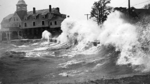 Waves crashing onshore in Woods Hole, Mass., during the 1938 hurricane. Large waves associated with intense hurricanes can erode and transport coastal sediments, as well as destroy infrastructure and threaten lives. Sediment transported by storm surge and waves  can be washed into coastal ponds and marshes, preserving a record of the storms passage. A new study examining these sediments found that intense hurricanes possibly more powerful than any storms New England has experienced in recorded history frequently pounded the region during the first millennium. Credit: WHOI