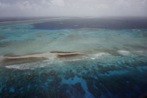 Aerial photograph of Kwajalein Atoll showing its low-lying islands and coral reefs. Credit: Curt Storlazzi/USGS